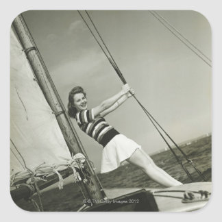 Woman Holding Rigging on Yacht Square Sticker
