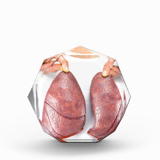 Woman holding two lung models in front of chest acrylic award