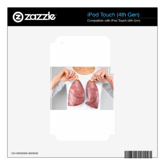 Woman holding two lung models in front of chest iPod touch 4G decal