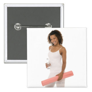 Woman holding water bottle and exercise mat 2 inch square button