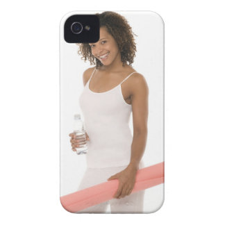 Woman holding water bottle and exercise mat iPhone 4 cover