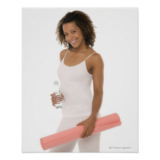 Woman holding water bottle and exercise mat poster