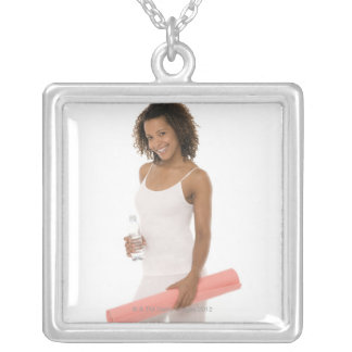 Woman holding water bottle and exercise mat silver plated necklace