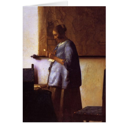 Woman in Blue Reading a Letter Card