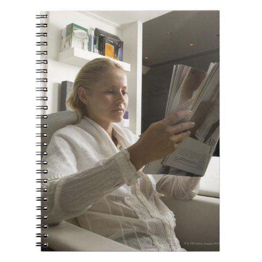 Woman in hairdressing salon notebook
