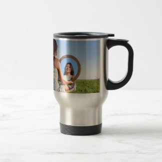 Woman in nature viewing her mirror image travel mug
