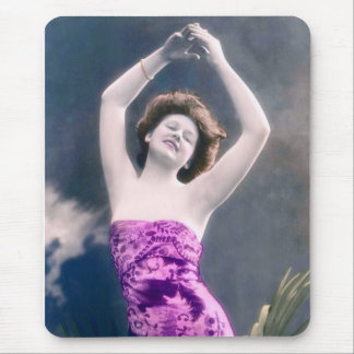 woman in purple sarong , arms raised as if dancing mouse pad