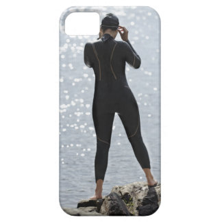 Woman in wetsuit standing on rock iPhone 5 cover