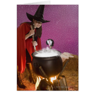 Woman in witch costume stirring cauldron card