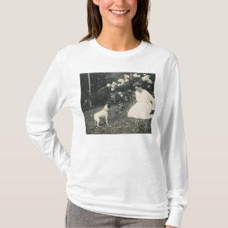 woman kneeling and dog shirt