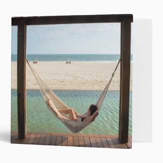 Woman Laying On A Hammock At A Small Hotel Binder