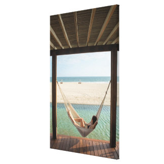 Woman Laying On A Hammock At A Small Hotel Canvas Print