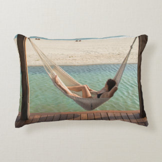 Woman Laying On A Hammock At A Small Hotel Decorative Pillow
