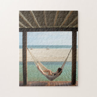 Woman Laying On A Hammock At A Small Hotel Jigsaw Puzzle
