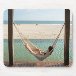 Woman Laying On A Hammock At A Small Hotel Mouse Pad