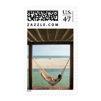 Woman Laying On A Hammock At A Small Hotel Postage Stamp