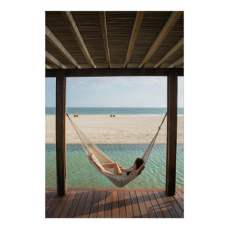 Woman Laying On A Hammock At A Small Hotel Poster