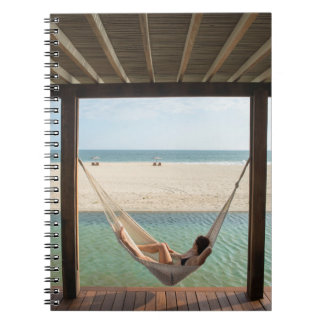 Woman Laying On A Hammock At A Small Hotel Spiral Notebook