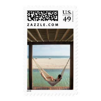 Woman Laying On A Hammock At A Small Hotel Stamps