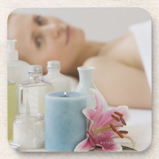Woman laying on spa table beverage coaster