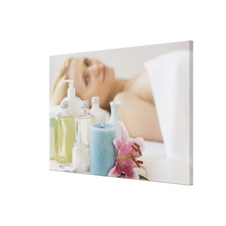 Woman laying on spa table canvas print