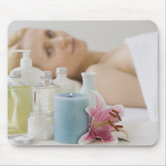 Woman laying on spa table mouse pad
