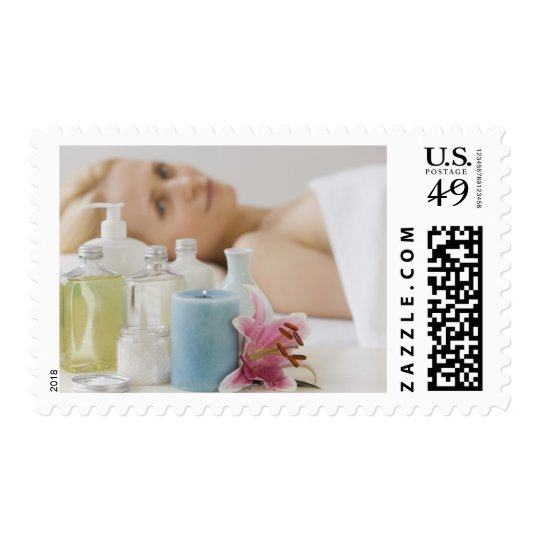 Woman laying on spa table postage