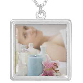 Woman laying on spa table silver plated necklace