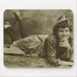 Woman laying on the grass mouse pads