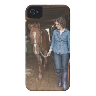 Woman leading horse iPhone 4 cases