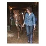 Woman leading horse postcard