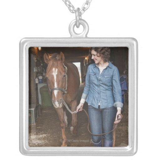 Woman leading horse square pendant necklace