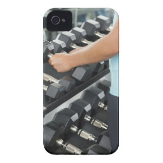 Woman lifting dumbbells 2 iPhone 4 case