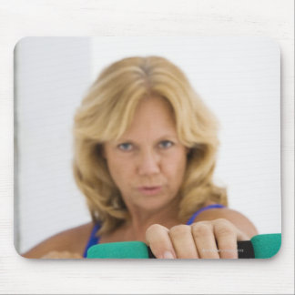Woman lifting dumbbells mouse pads