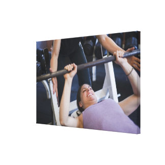Woman lifting weights 2 canvas print
