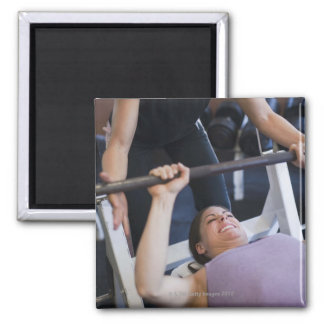 Woman lifting weights 2 magnet
