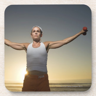 Woman lifting weights 4 drink coaster