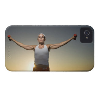 Woman lifting weights 4 iPhone 4 cover