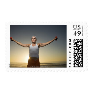 Woman lifting weights 4 postage