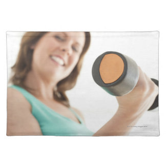 Woman lifting weights cloth placemat