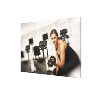Woman lifting weights in gym 2 gallery wrap canvas