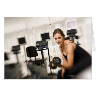 Woman lifting weights in gym 2 greeting card