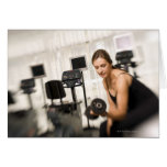 Woman lifting weights in gym 2 cards