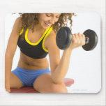 Woman lifting weights mousepad