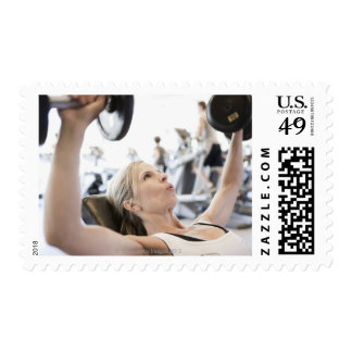 Woman Lifting Weights Postage