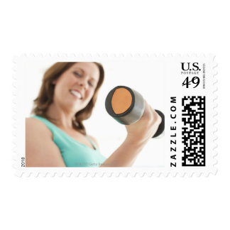 Woman lifting weights postage stamps