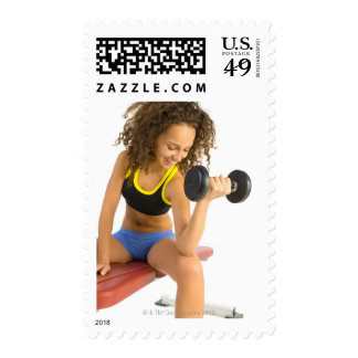 Woman lifting weights stamp