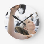 Woman Lifting Weights Round Clocks