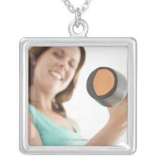 Woman lifting weights silver plated necklace
