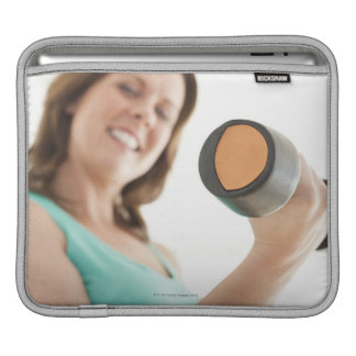Woman lifting weights sleeves for iPads